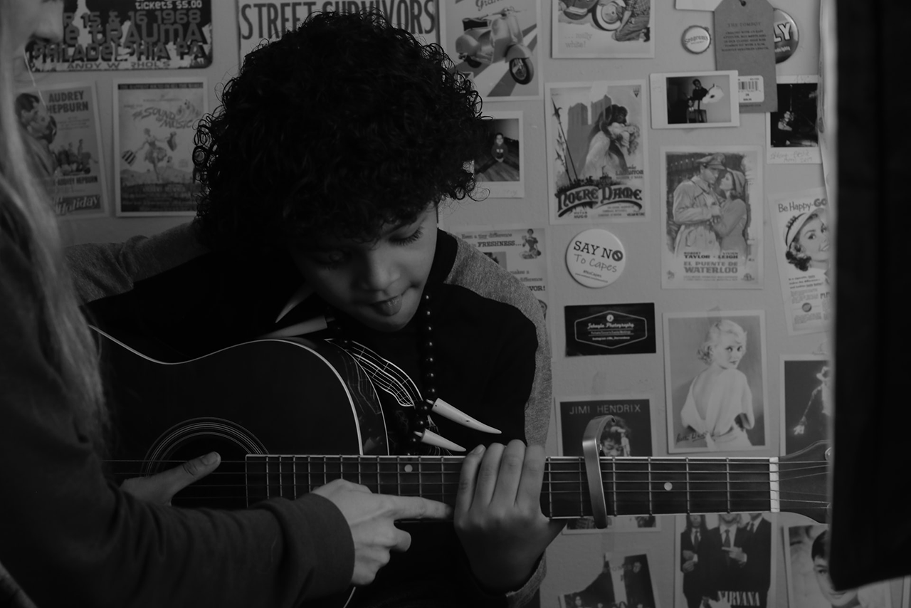 boy-guitar-lesson-bw